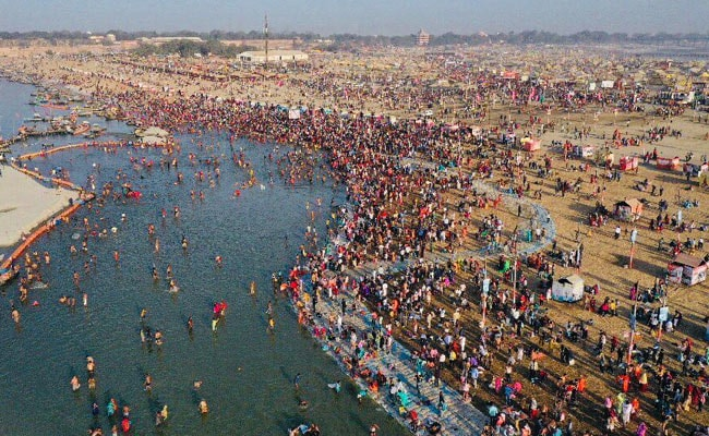 Pics: Thousands of Devotees Take Holy Dip On The Occasion Of Magha Purnima